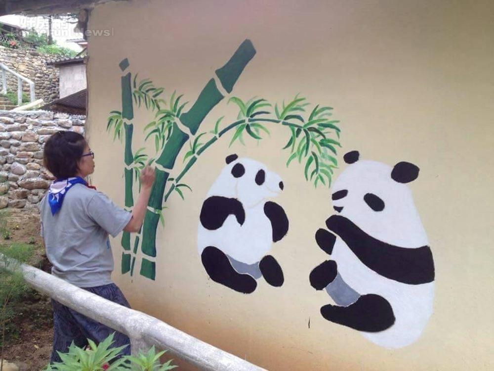 6.吳淑丸到泰北邊界的密窩村,幫當地人家彩繪牆壁。