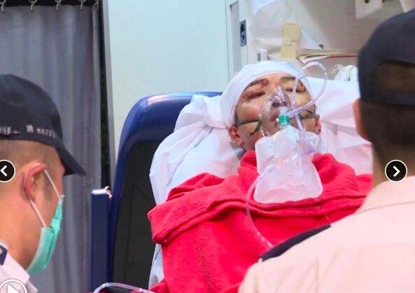 民陣召集人岑子杰在旺角遇襲,已被救護車送往廣華醫院救治。圖/翻攝自香港電台網站