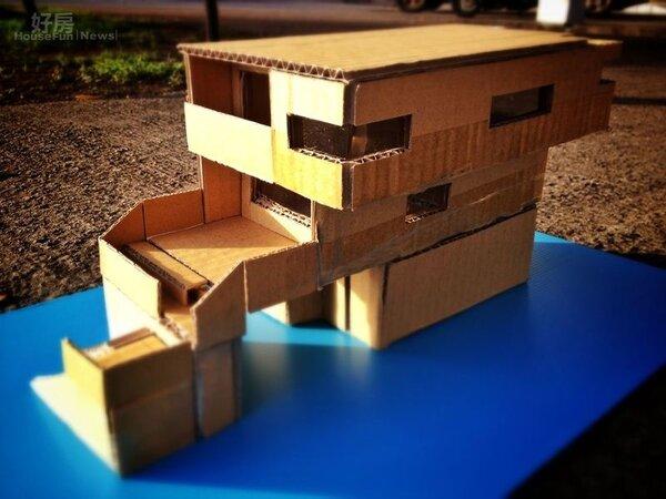 用厚紙板做的立體房屋,就是未來家的藍圖。